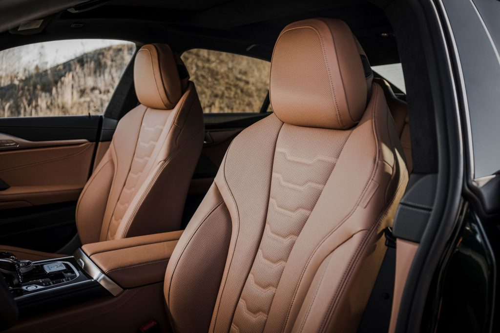 The brown-leather-upholstered interior of the 2022 BMW Alpina B8 Gran Coupe