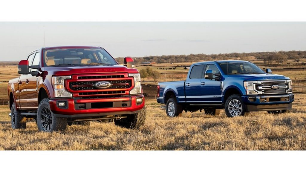 A pair of 2022 Ford F-250 Super Duty trucks one in red and one in blue