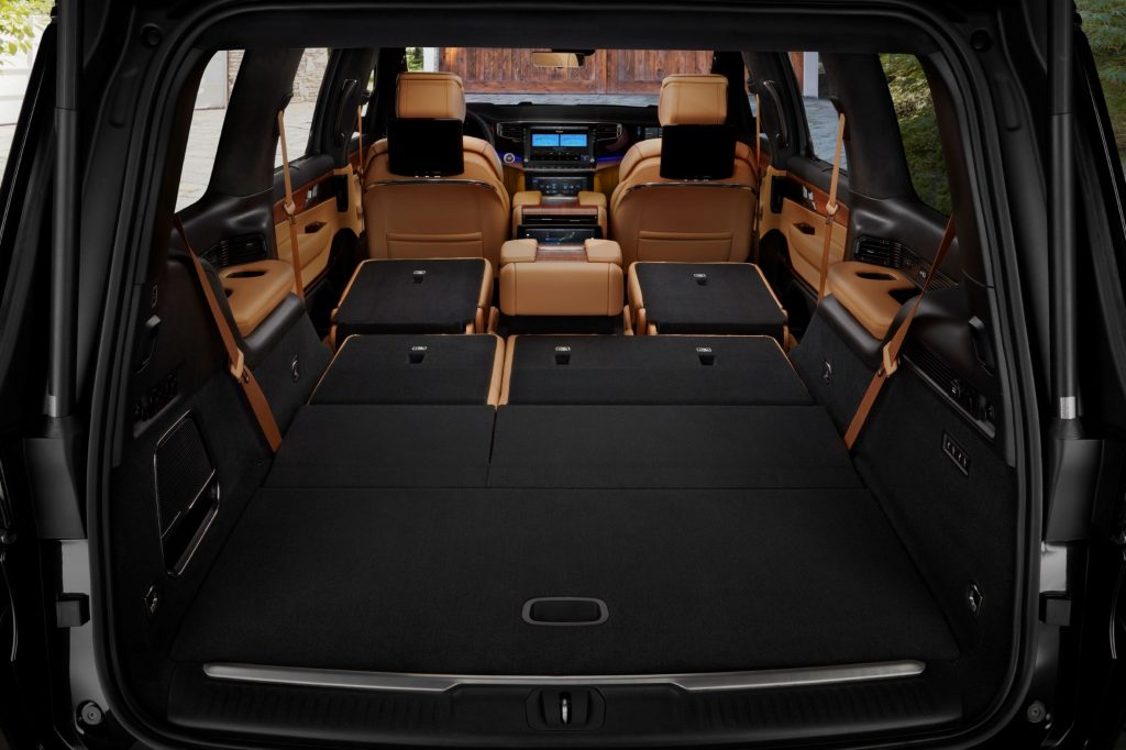 The rear view of the tan-leather interior of a 2022 Jeep Grand Wagoneer with its second- and third-row seats folded
