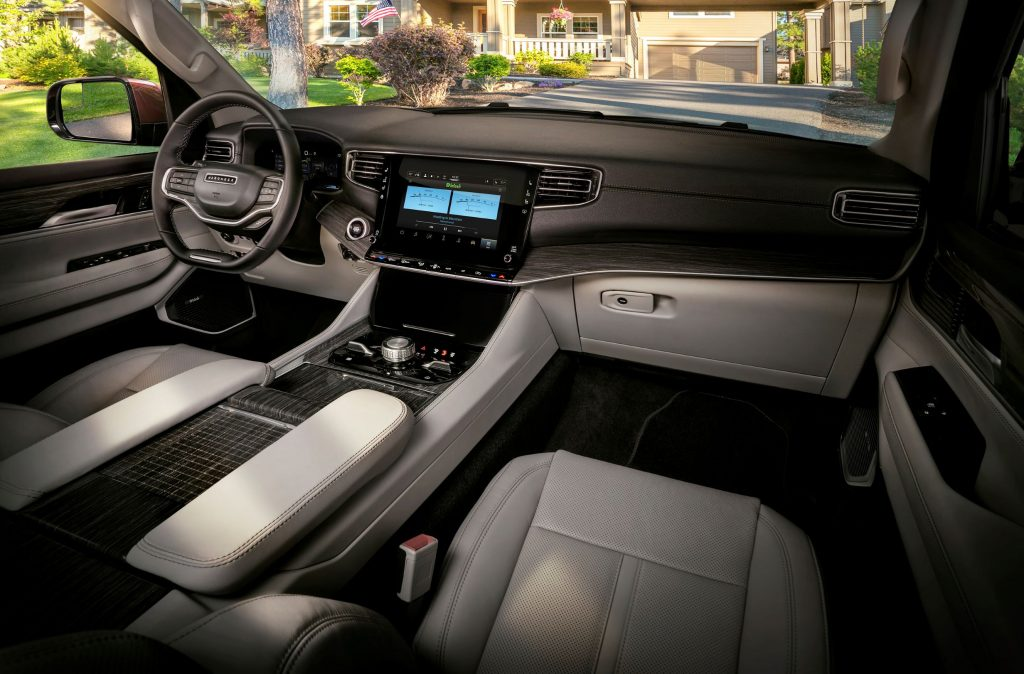 The white-leather front seats and brown dashboard of a 2022 Jeep Wagoneer
