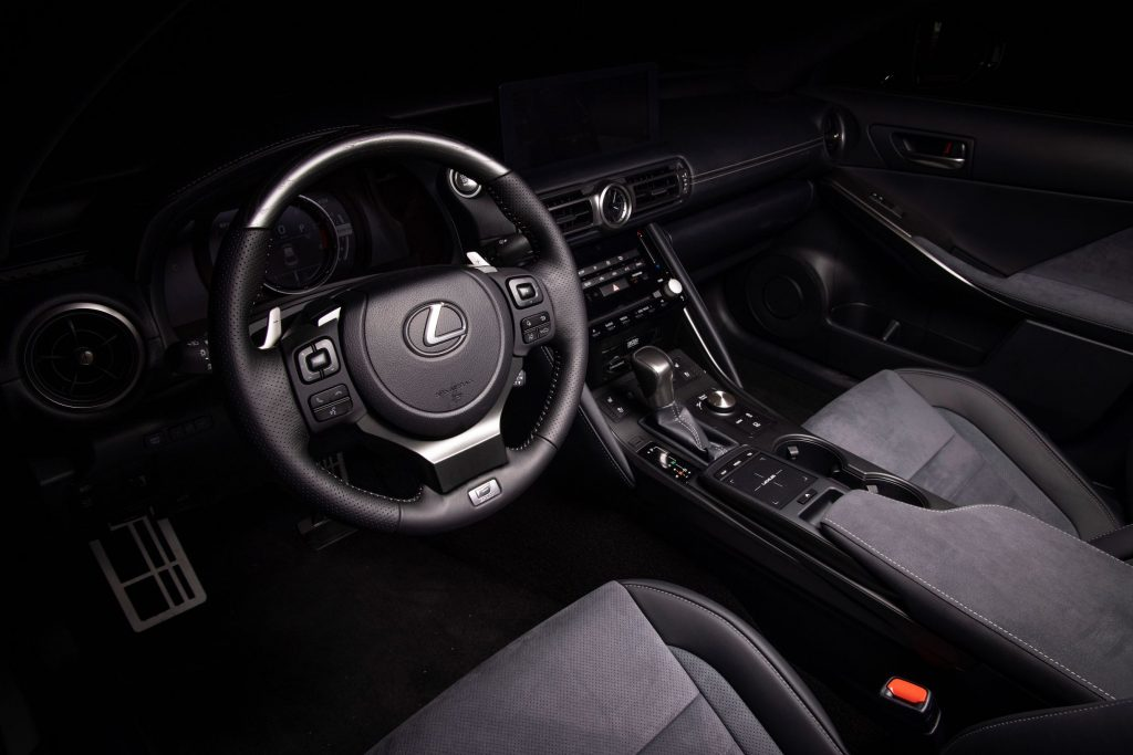 The black-and-gray suede-trimmed front seats and dashboard of a 2022 Lexus IS500 F Sport Performance Launch Edition