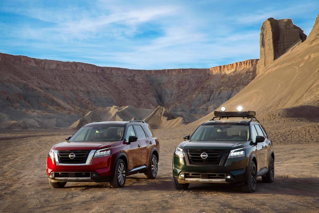 Two nissan pathfinders in the desert