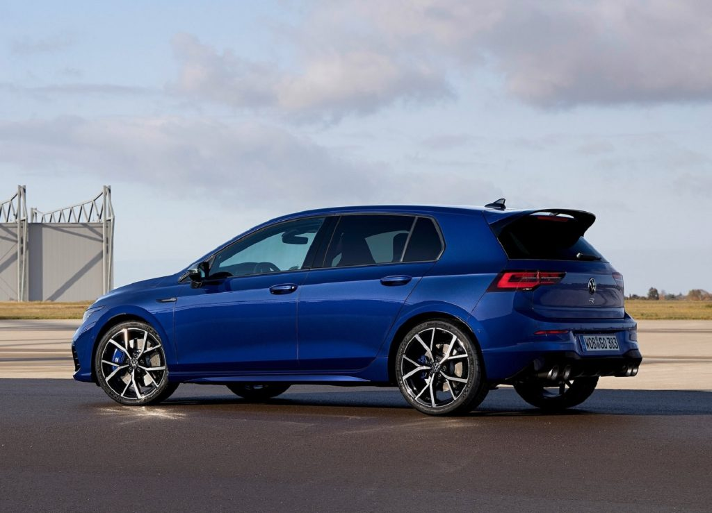 The rear 3/4 view of a blue 2022 Volkswagen Golf R on an airstrip