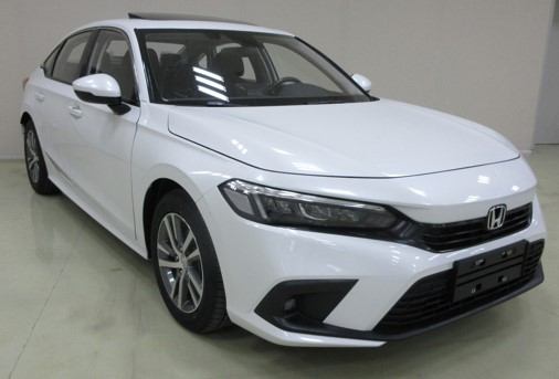 An image of a white 2022 Honda Civic ahead of its global debut.
