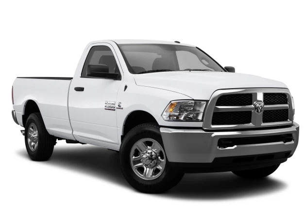 the Ram 1500 used pickup truck model from 2014 in a press photo against a white back drop