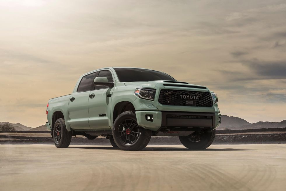 a 2021 toyota tundra trd pro in Lunar Rock shoing up its aggressive stance in the desert