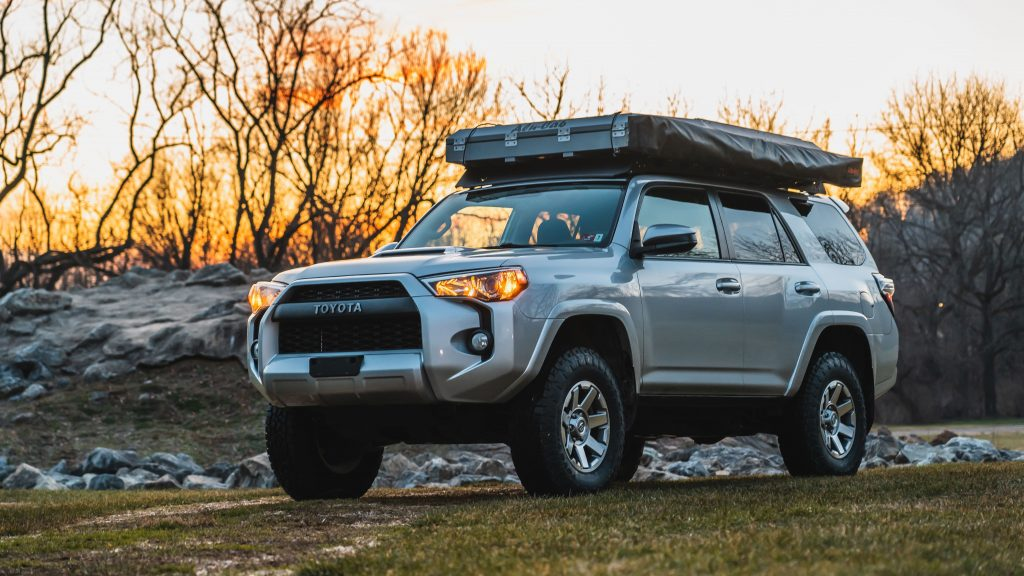 the mountain state overland 4runner build parked in the grass in the woods