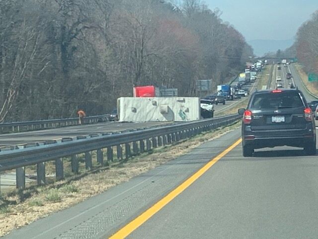 An RV on it's side blocking I-40 traffic