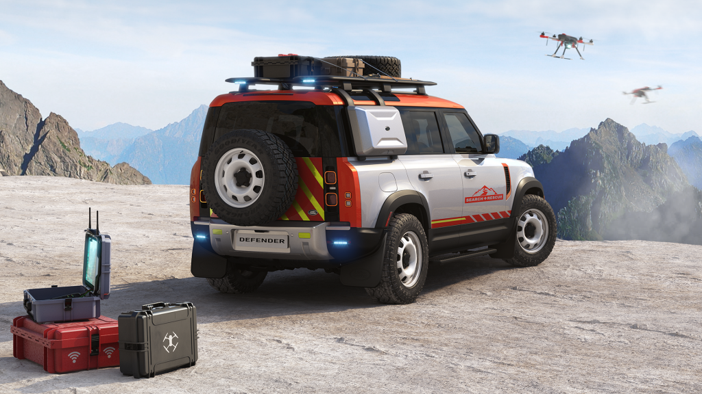 serach and resue land rover defender concept on the edge of a cliff escorted by flying rescue drones