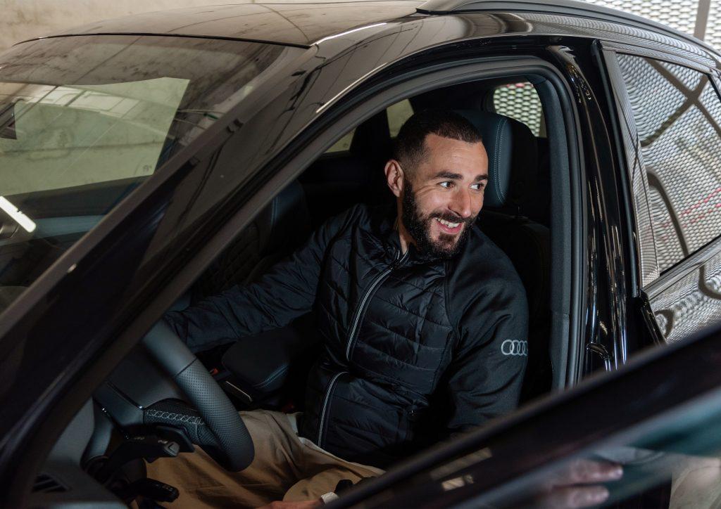 Karim Benzema behind the wheel of a new black Audi sedan