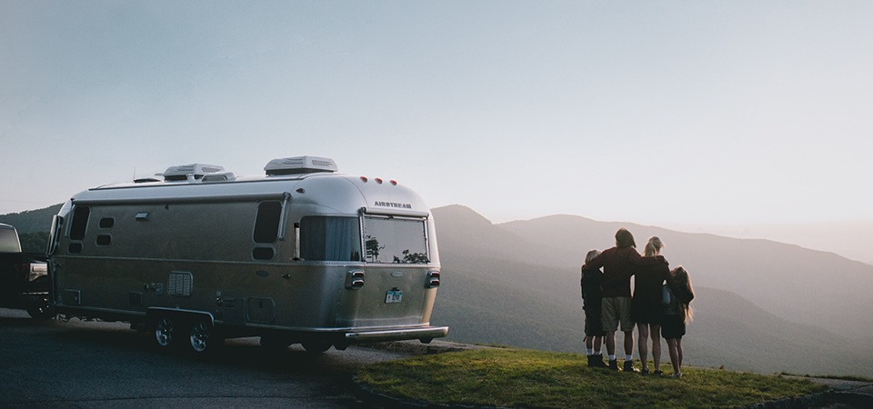 A family enjoying the view with their Airstream Flying Cloud travel trailer