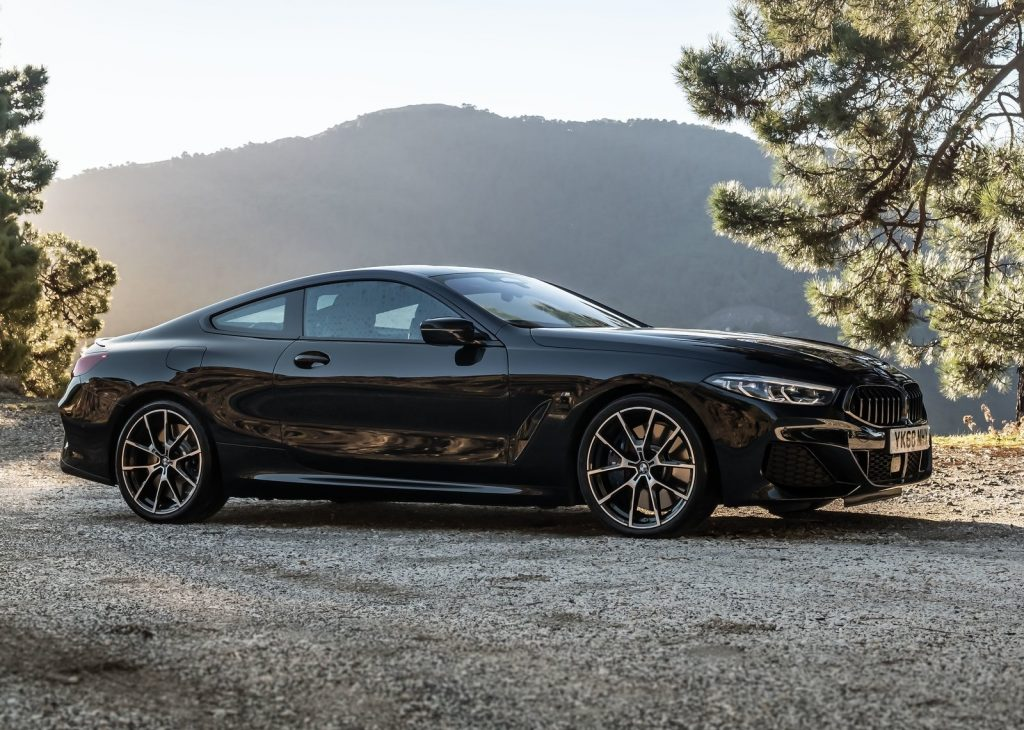 A black BMW 8-Series outdoors on the road.