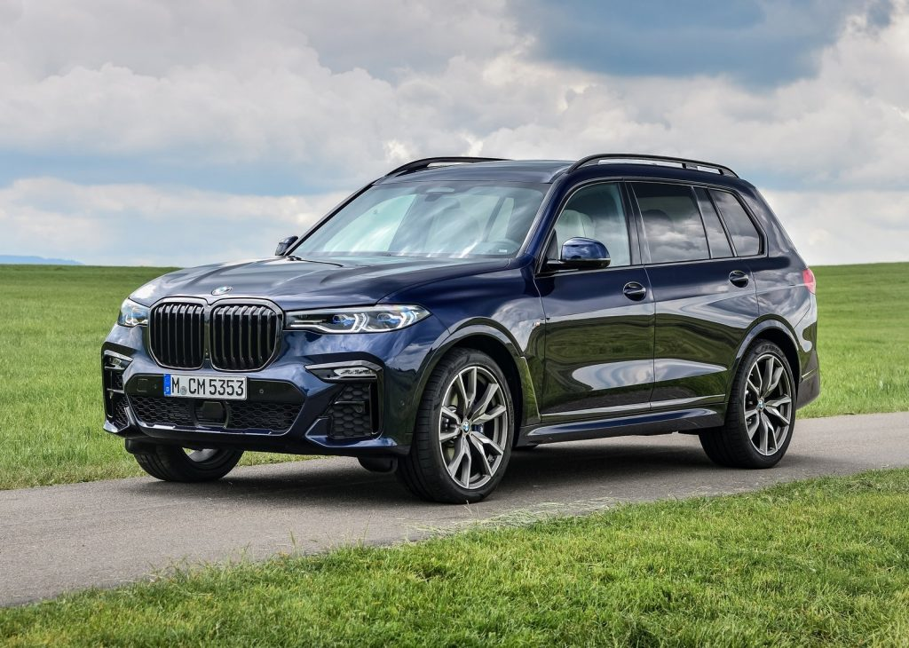 An image of a BMW X7, one of the luxury SUVs Consumer Reports recommends, parked outside.