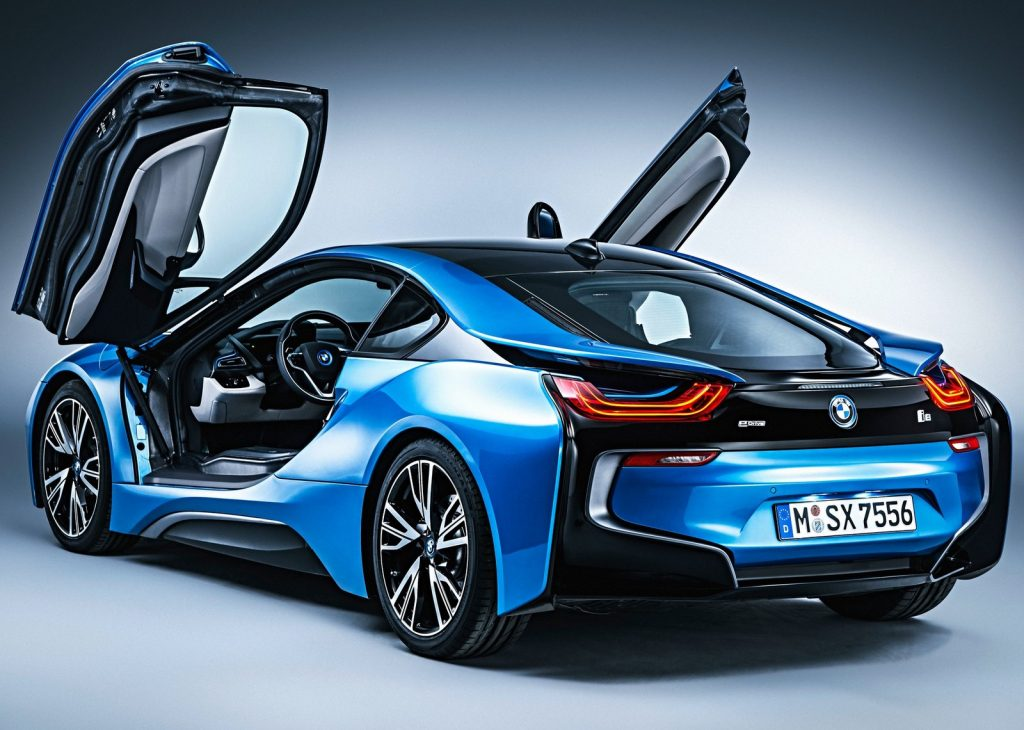 An image of a blue BMW i8 photographed inside of a studio.