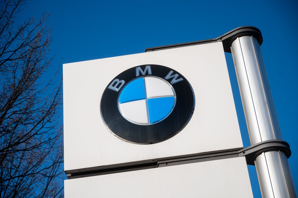 A BMW logo stands in front of the BMW plant in Berlin. At the end of the peace period in the metal and electrical industry, the employees have called for a warning strike
