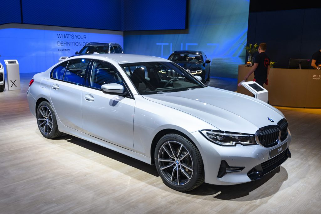 A Silver BMW 3 Series sedan sits on display at an auto show