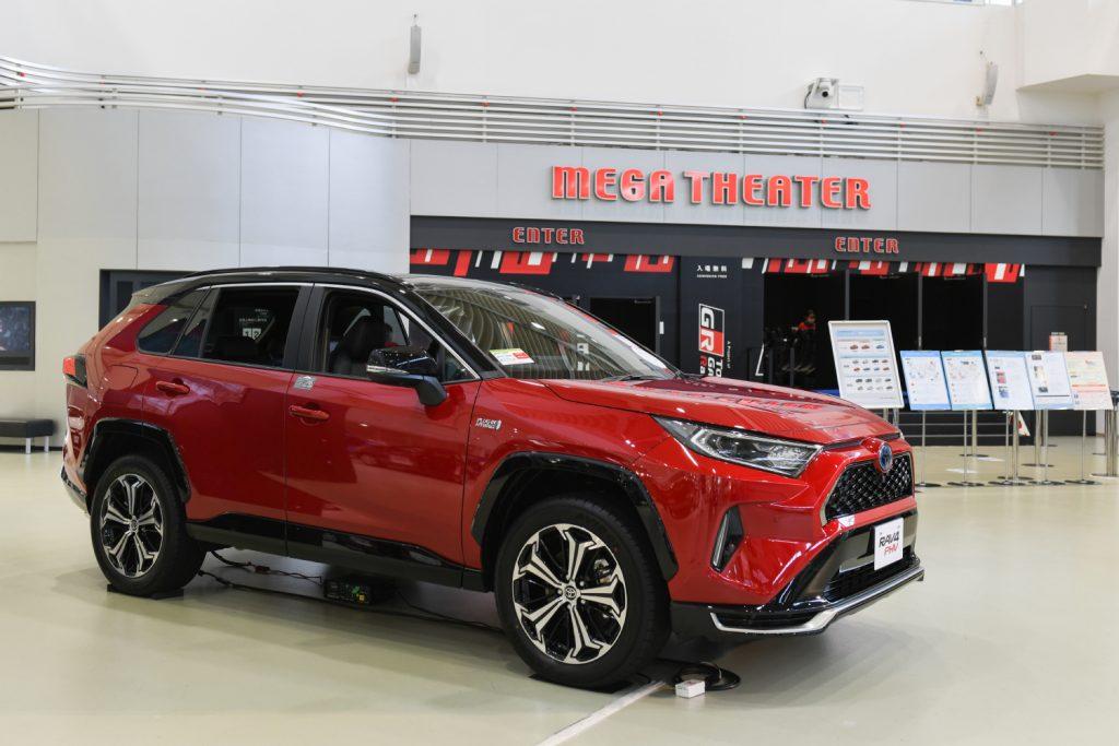 A red RAV4 plug-in hybrid Toyota SUV sits on display