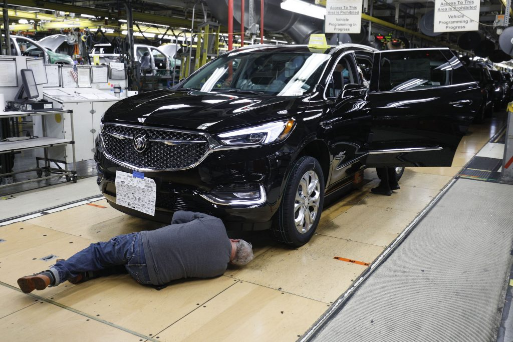 General Motors Chevrolet Traverse and Buick Enclave vehicles go through the assembly line at the General Motors Lansing Delta Township Assembly Plant