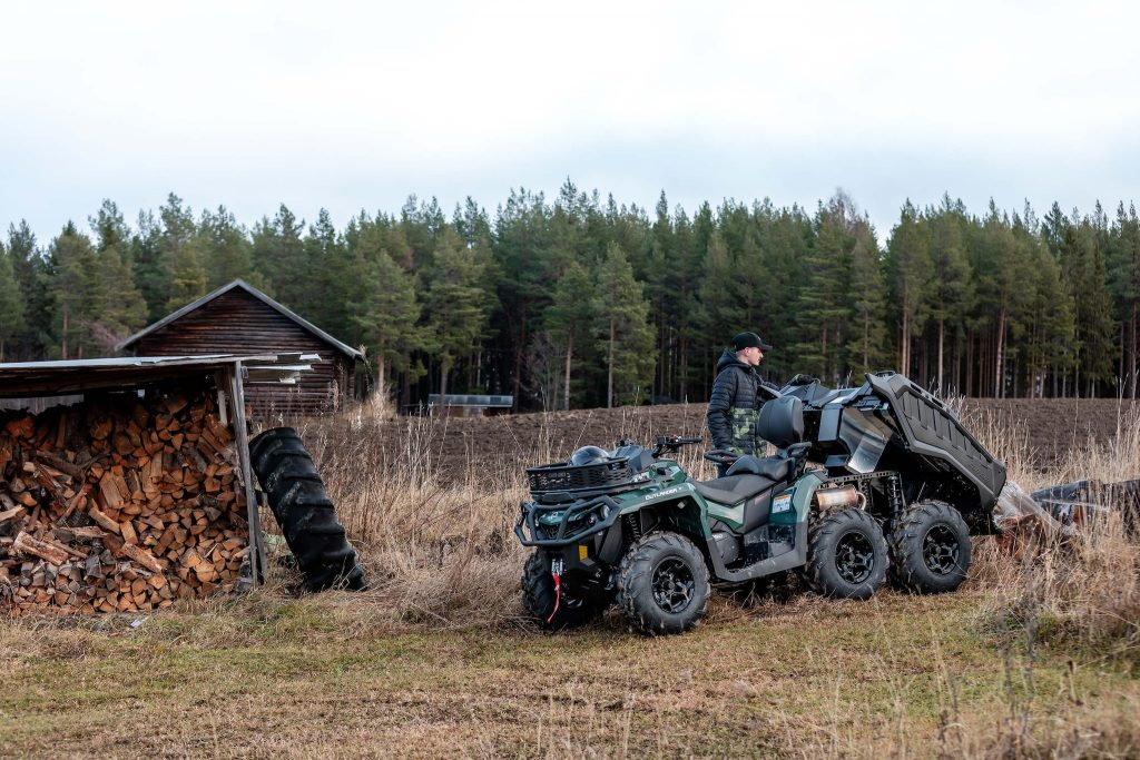 The Can-Am Outlander doing work on a rustic ranch
