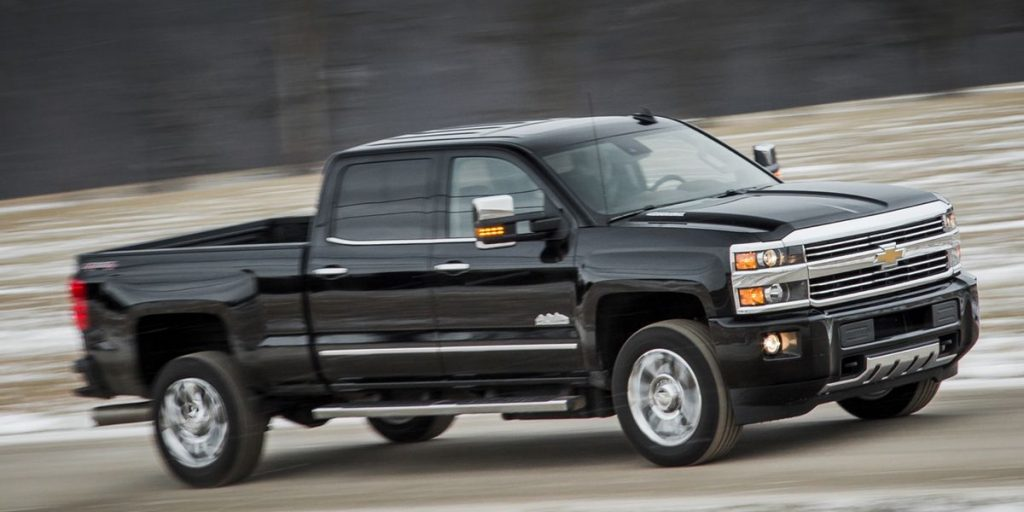 a black 2016 chevrolet silverado 2500 HD at speed