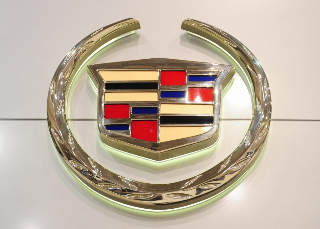 A Cadillac logo displayed on a sign representing one of General Motors luxury brands