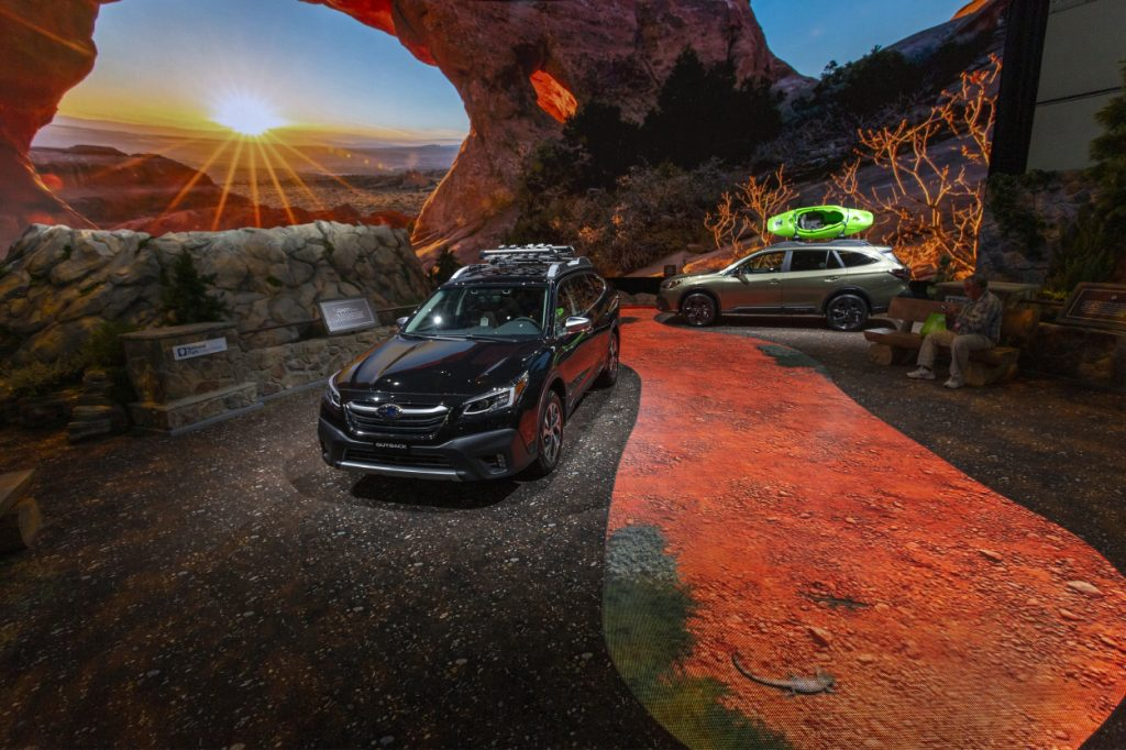 Two Subaru Outback on display at an auto show