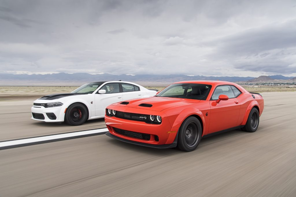 An image of a Dodge Challenger and Charger out on an airfield.