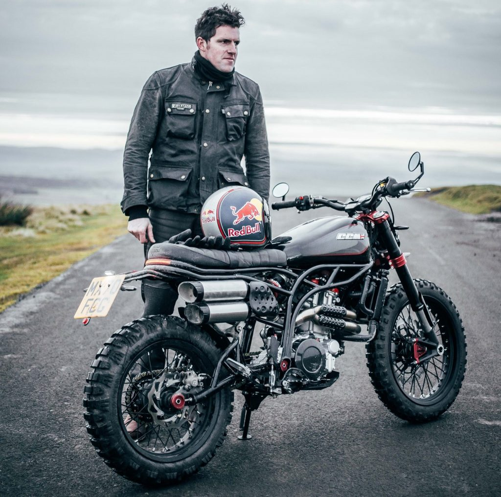 British rider Dougie Lampkin with a black-and-red CCM Spitfire Blackout on a road