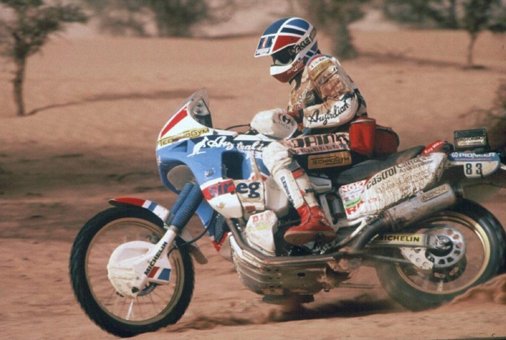 Edi Orioli racing in the 1989 Paris-Dakar Rally on the white-blue-and-red Honda NXR750