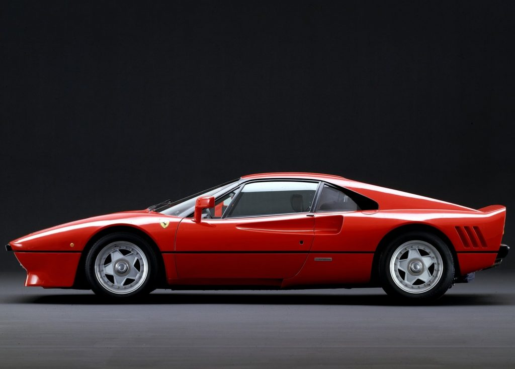 An image of a Ferrari 288 GTO parked inside of a studio.