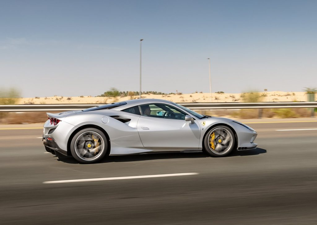 An image of a silver Ferrari F8 Tributo outdoors.