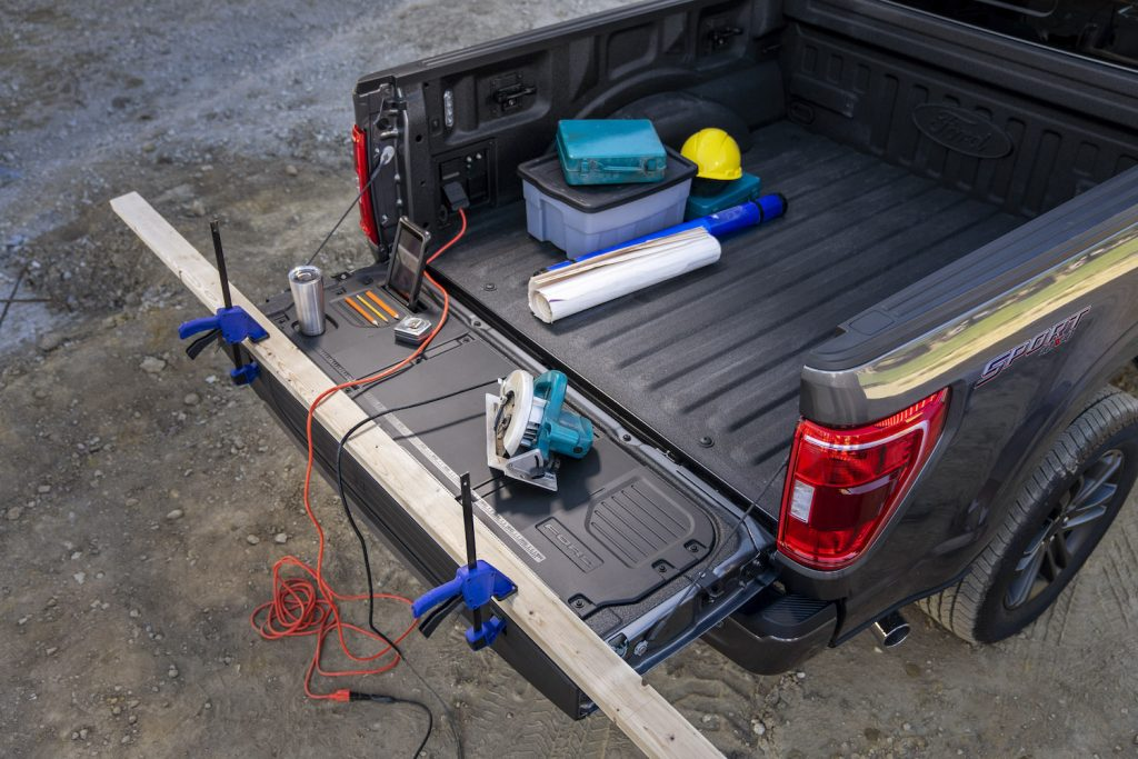 The Ford F-150 features an available tailgate work surface.