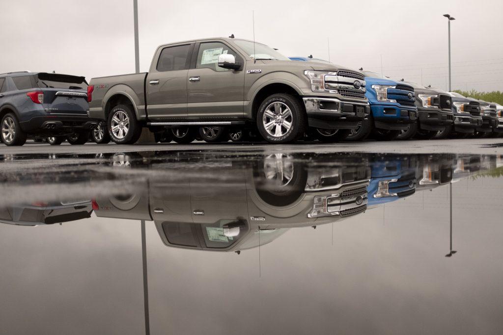 A row of Ford F-150 trucks at car dealership