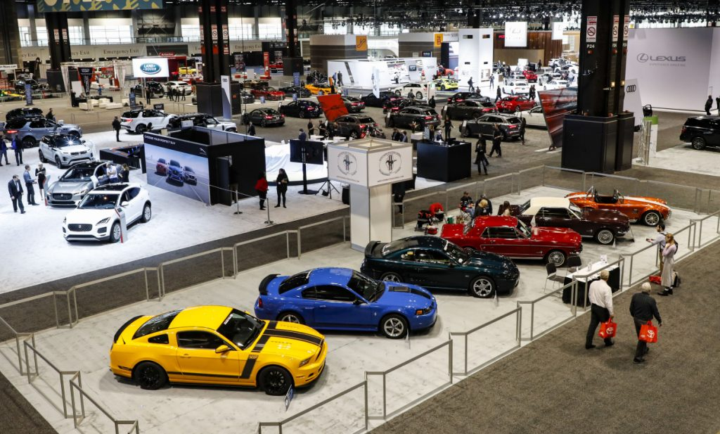 A row of Ford Mustang cars on display at an auto show