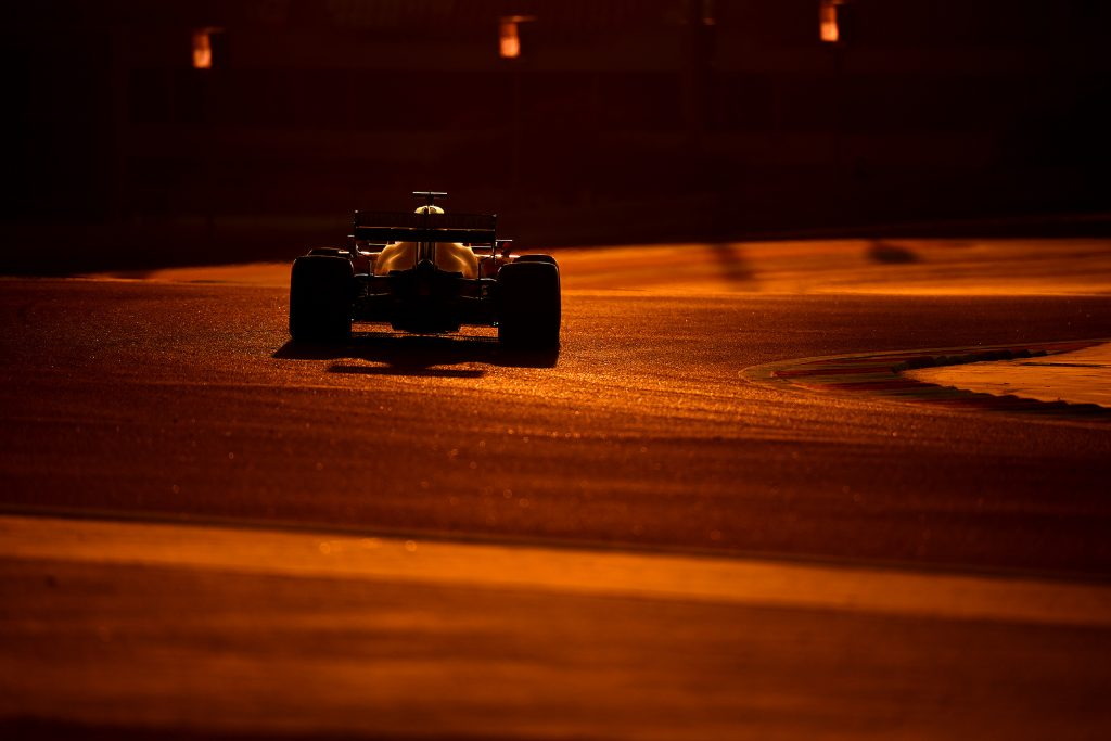 Formula 1 driver going around Bahrain at dusk