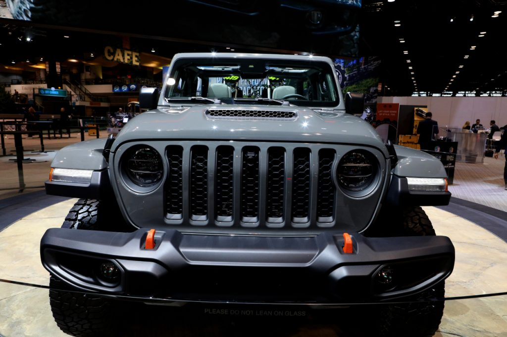 The front grille of a Jeep Gladiator on display at an auto show