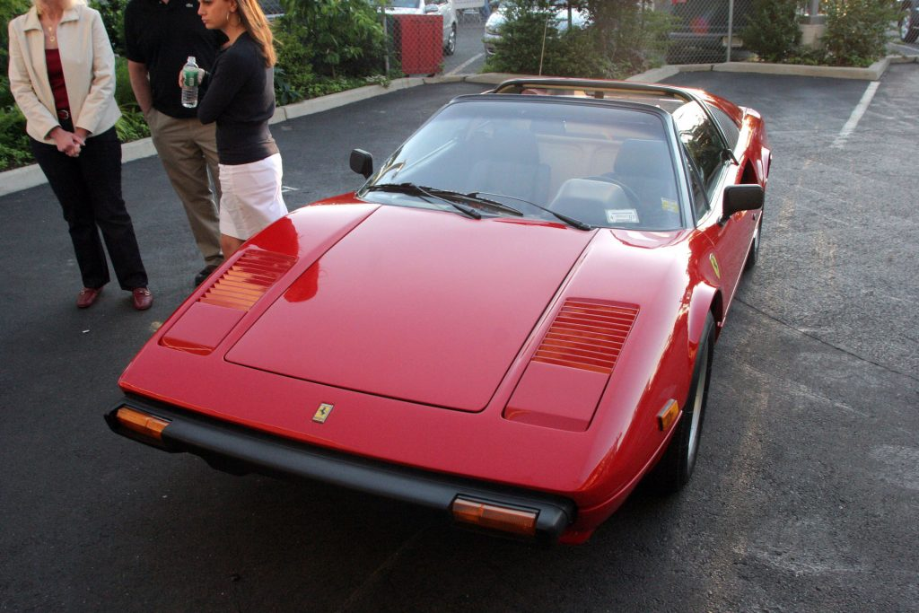An image of a Ferrari 308 parked outdoors.