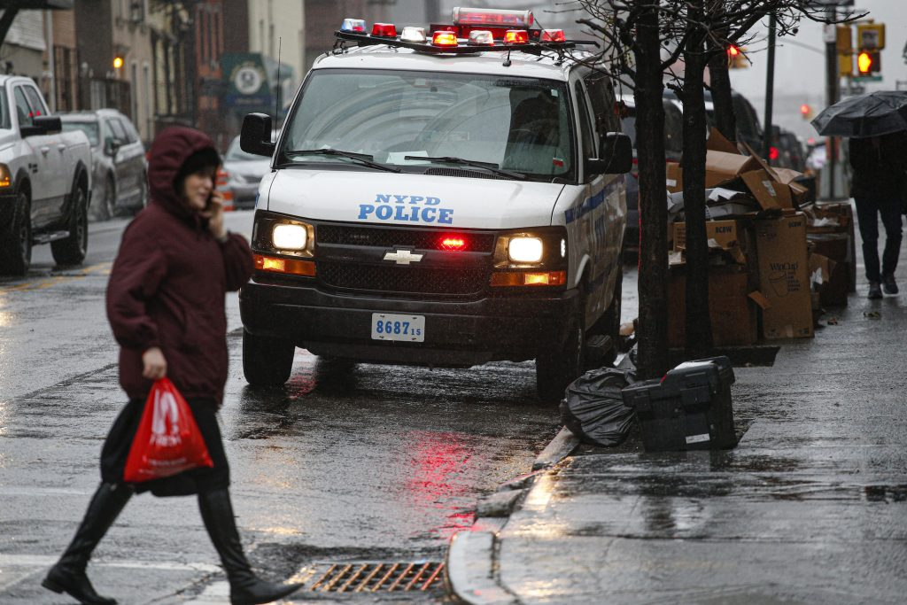 NYPD van next to the side walk