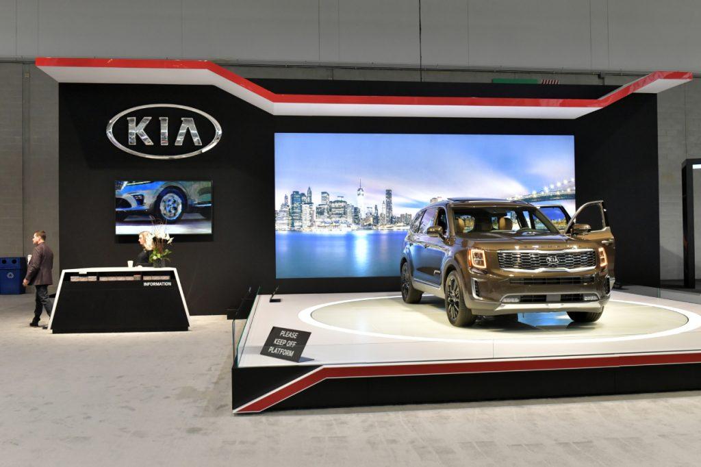 A Kia Telluride on display on a stage
