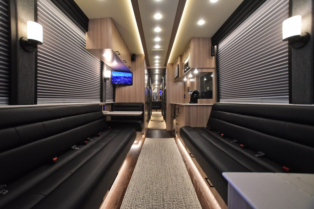 The black and beige lounge inside a Hemphill Brothers Coach Company luxury RV