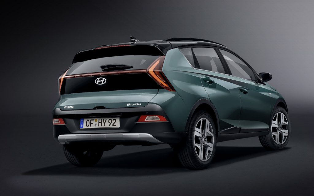 A look at the rear end and side of the Hyundai Bayon crossover in front of a grey background
