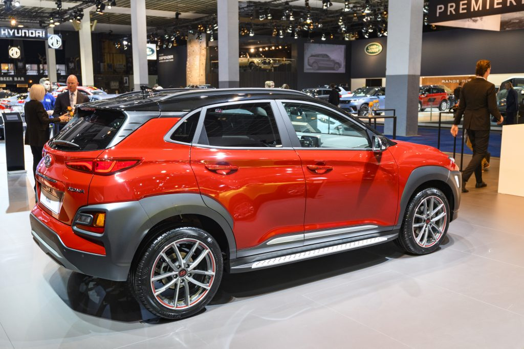 Red Hyundai Kona compact crossover SUV on display at Brussels Expo