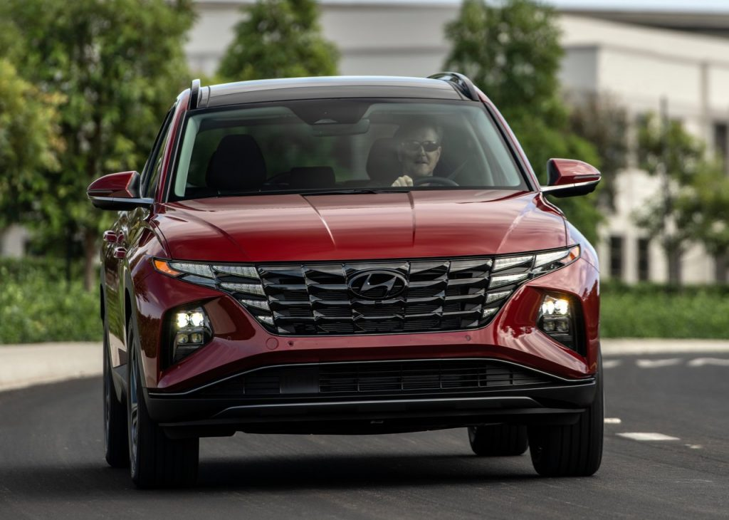 An image of a 2022 Hyundai Tucson driving outdoors.