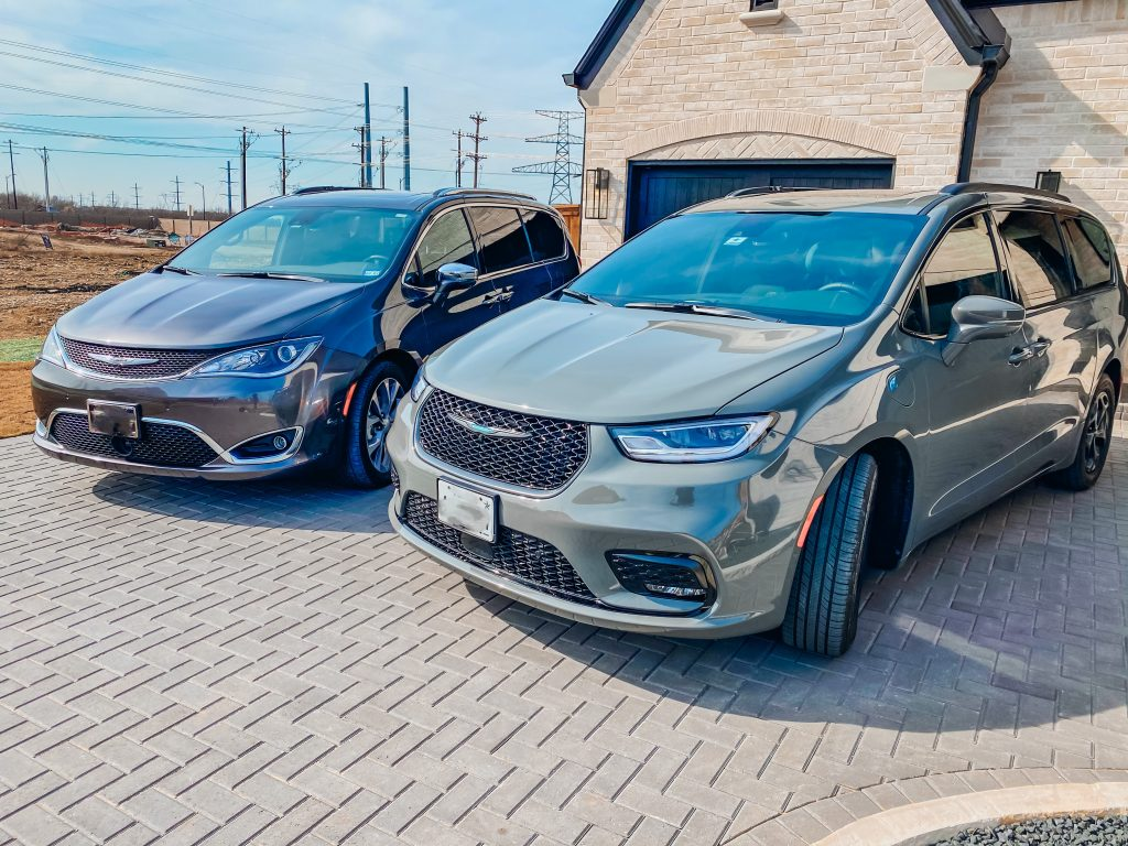 2020 and 2021 chrysler pacifica models in a driveway