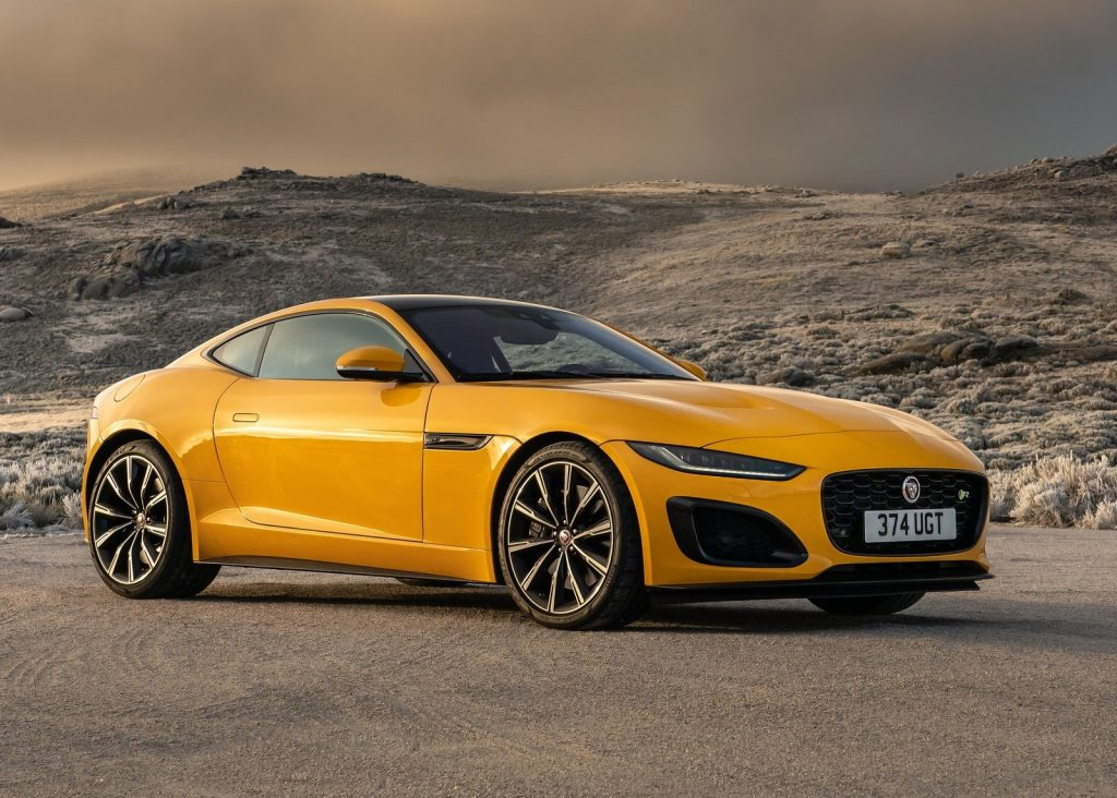 An image of a yellow Jaguar F-Type parked outside.