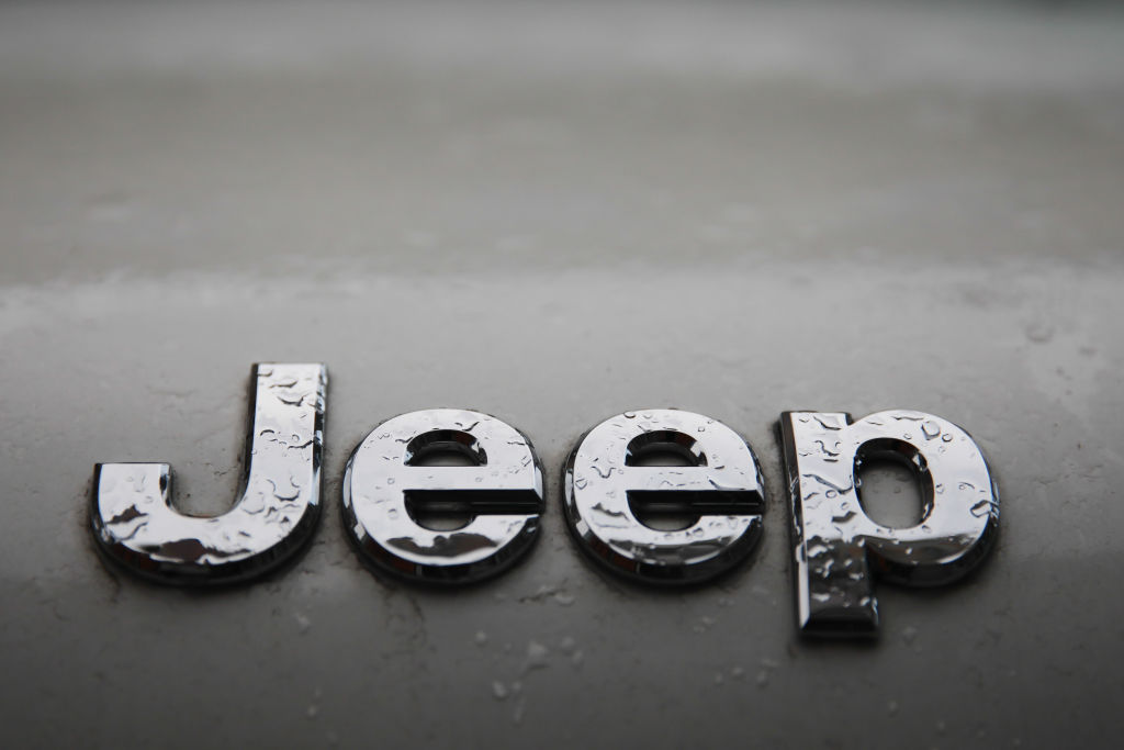 A rain-covered Jeep logo covered in rain drops
