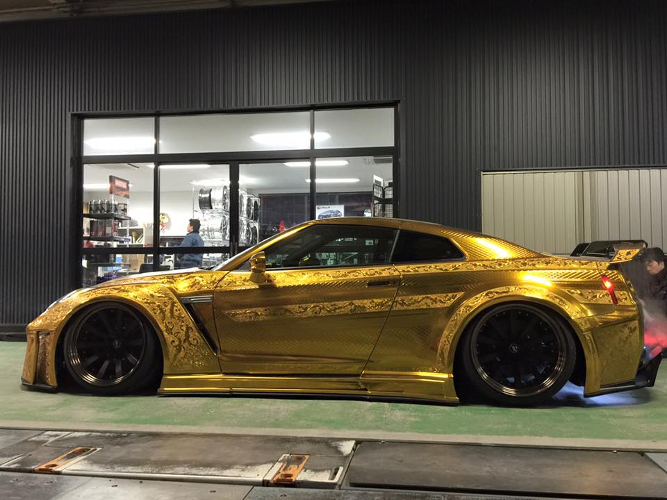 side view ofKuhl Racing gold chrome engraved Nissan GT-R