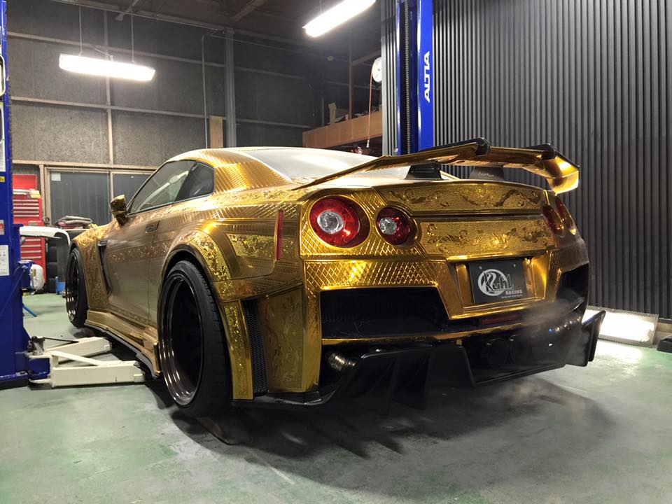 Kuhl Racing gold chrome engraved Nissan GT-R rear 3/4 view