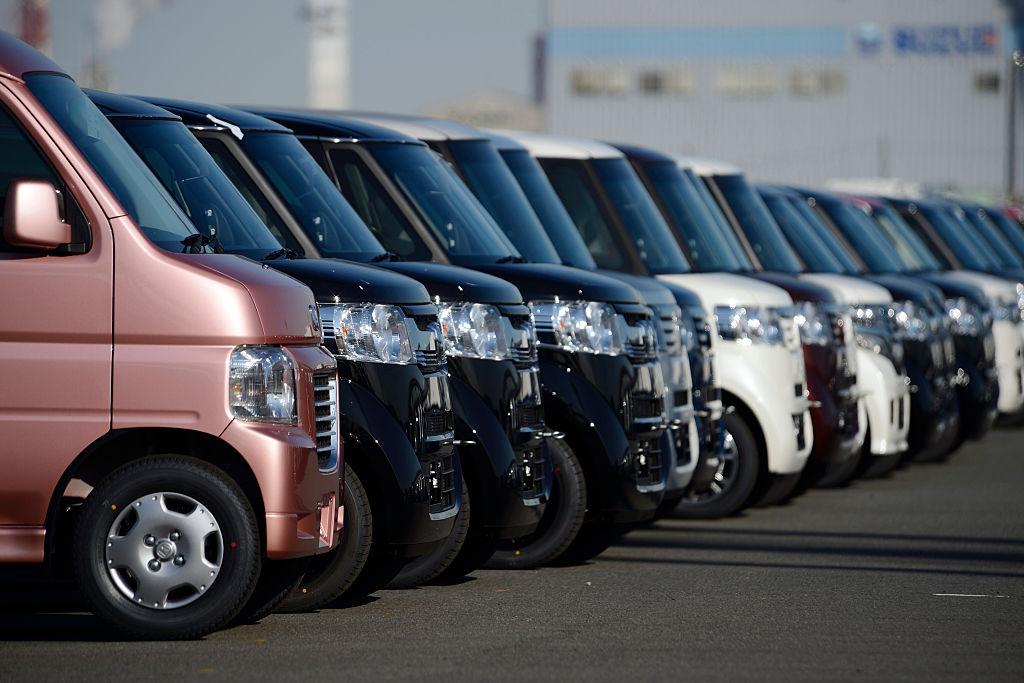 lineup of Japanese vans at port in Japan