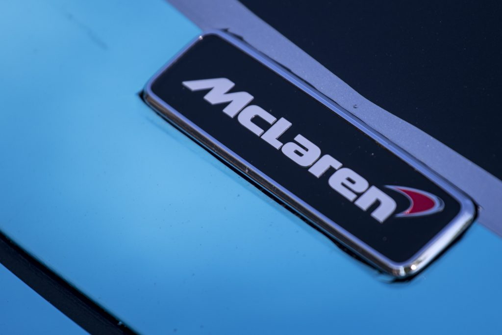 The McLaren logo on a vehicle emblem
